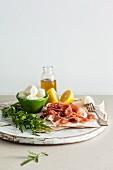 Ingredients for salad with Prosciutto and bocconcini mozzarella