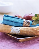 Cotton napkins with hand-made, delicate wooden napkin rings
