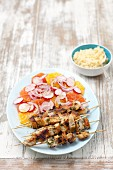 Pork skewers with a citrus fruit salad and couscous