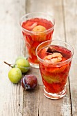 Glasses of plum compote with cinnamon