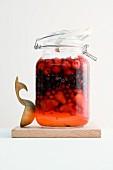 A jar of berries preserved in rum