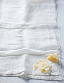 A piece of Parmesan and grated Parmesan on a muslin cloth
