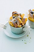 Scheiterhaufen (bread bake with apples, cinnamon, raisins and almonds) with oranges