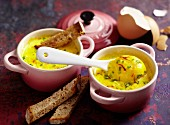 Oeufs cocotte with saffron and bread soldiers
