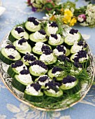 Cucumber slices with cream cheese and caviar for a mid-summer festival