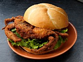 Breaded soft shell crab on a white roll