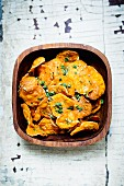 Sweet potato crisps with parsley and salt
