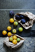 An arrangement of various plums