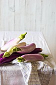 Purple and white aubergines on a table