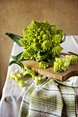 Fresh Romanesco broccoli on a wooden board