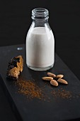 A bottle of almond milk, almonds and chaga