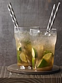 Two Caipirinhas with straws