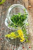 A gherkin jar filled with herbs