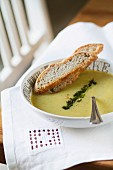 Cream of vegetable soup with two slices of bread