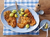 Wiener Schnitzel (breaded veal escalope) with parsley potatoes