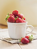 Fresh strawberries in a white cup