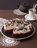 Creamy cherry cake with grated chocolate, sliced