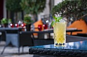 A ginger cocktail on a patio table (Buddha-Bar Hotel, Paris)