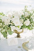 Bouquet of white flowers on outdoor wedding table (Ravello, Italy)