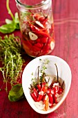 Preserved chilli peppers with herbs