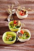 Lamb's lettuce soup with branzini skewers