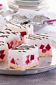 Cream slices with red jelly cubes