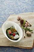 Sea trout in herb stock with trout caviar