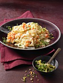 Carrot and celery noodles with cress and almond gremolata