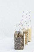 Chia, sunflower seeds and quinoa in milk bottles