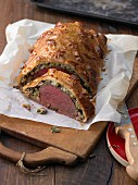 Roast beef fillet wrapped in puff pastry, sliced