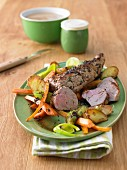 Roast pork fillet with potatoes, carrots and leek