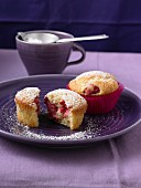 Cream cheese muffins with raspberries and icing sugar