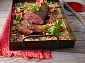 Oven-baked beef fillet with mushrooms and tomatoes