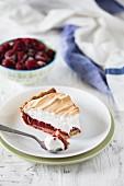 A slice of raspberry meringue tart