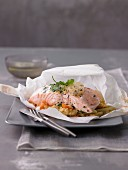 Salmon with couscous in parchment paper