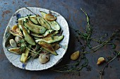 Courgette wedges with garlic and thyme fried in olive oil