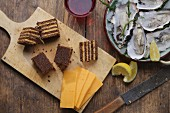Pumpernickel with cheddar, oysters and lemons