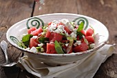 A watermelon salad with feta cheese and mint