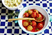 Fish dumplings in tomato sauce