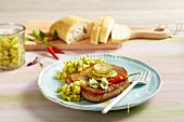 Fried tuna fish steak with an avocado salsa