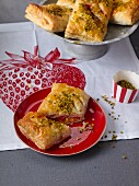 Puff pastries filled with strawberries and pistachios