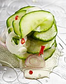 Spicy cucumber salad with onions and chilli peppers