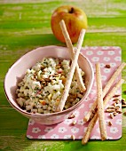 Apple and kohlrabi coleslaw with breadsticks and sunflower seeds