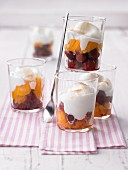 Quick layered deserts with cherries, peaches and cream