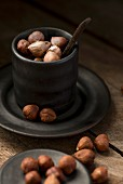 Hazelnuts and porcelain cup
