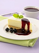 Cheesecake with blackcurrant sauce