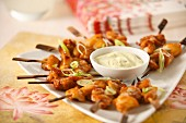 Oriental chicken skewers with a dip