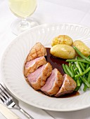 Roast duck breast with gravy, potatoes and green beans