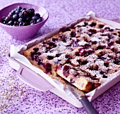 Summer cake with blueberries and icing sugar