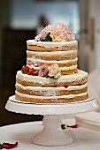Naked cake – a layered wedding cake with mascarpone cream and strawberries